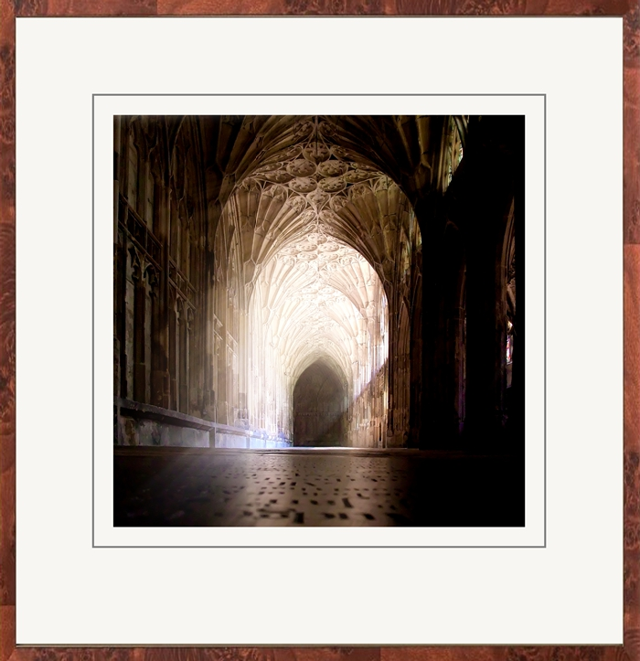 A beautiful walnut frame and a weighted mount draw the eye into the light-show that is this famous cloister