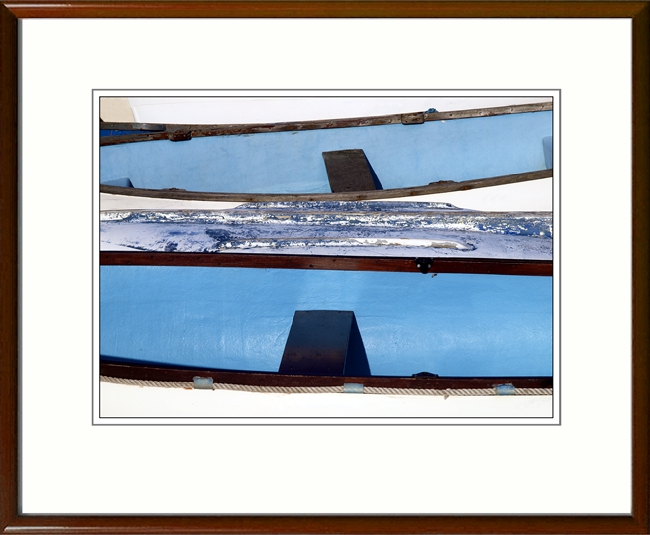 A smart wood frame matches the wood on the boats, though not necessarily the colour.
