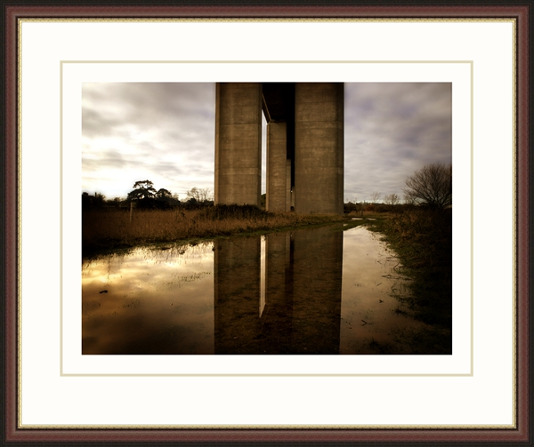 Simple wood frame with a gold-coloured insert to reflect the colours of the picture