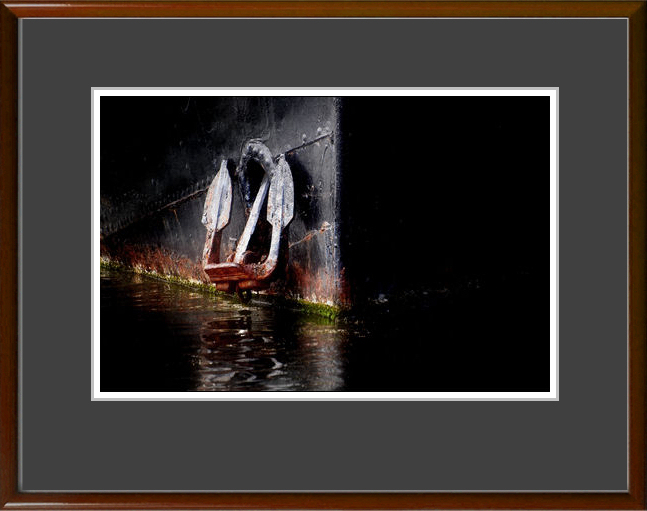 Framed with a thin float and a dark, neutral-coloured mount. Wood or metal frame.